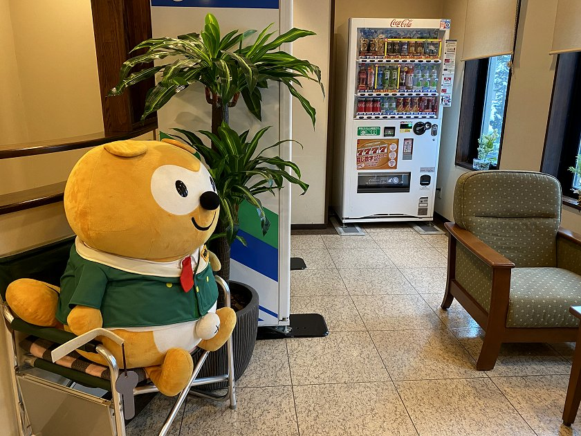 OK, that's different! (Stuffed cartoon character sitting in Reception)