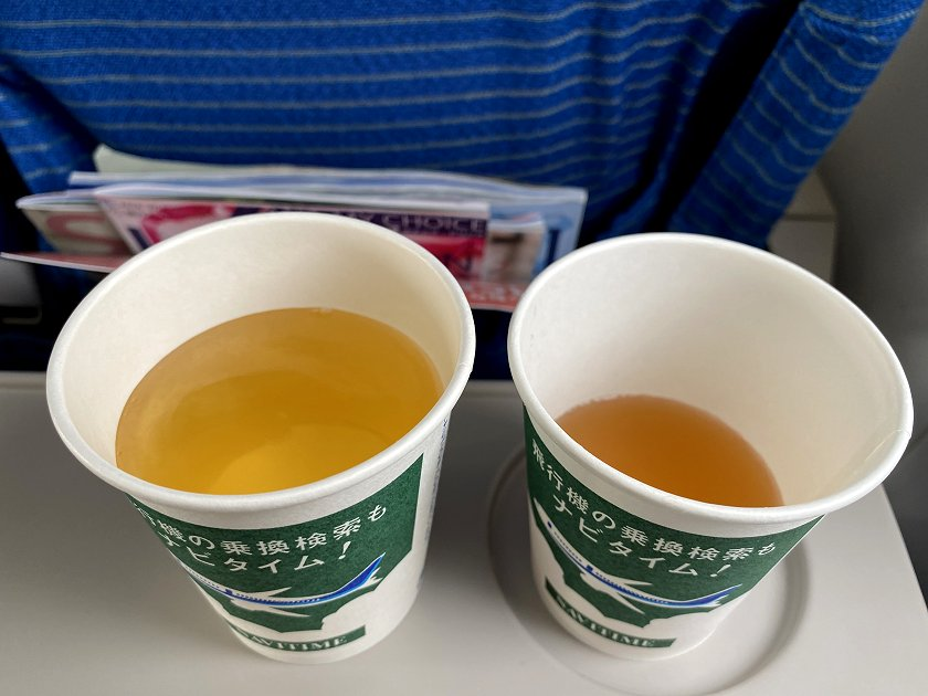 Unusual beverage service: hot consommé (left) and apple juice (right)