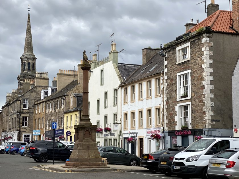 The Mercat Cross is in the High Street
