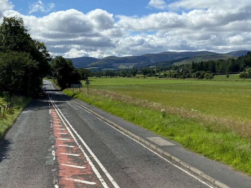 Approaching Peebles at speed, from the top deck of an X62 bus