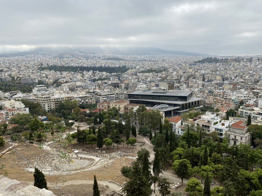 A look back to where we started the climb, showing the Theatre of Dionysus and the Acropolis Museum