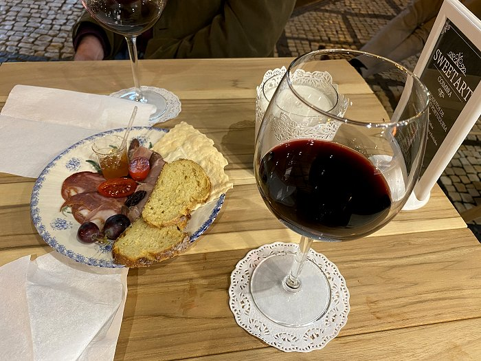 We stopped in R. Ferreira Borges  to sample some red wine and a snack