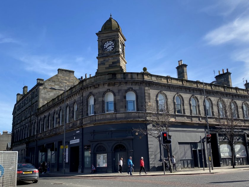 The L-shaped building and clock tower are all that remain of the former Leith Central Station