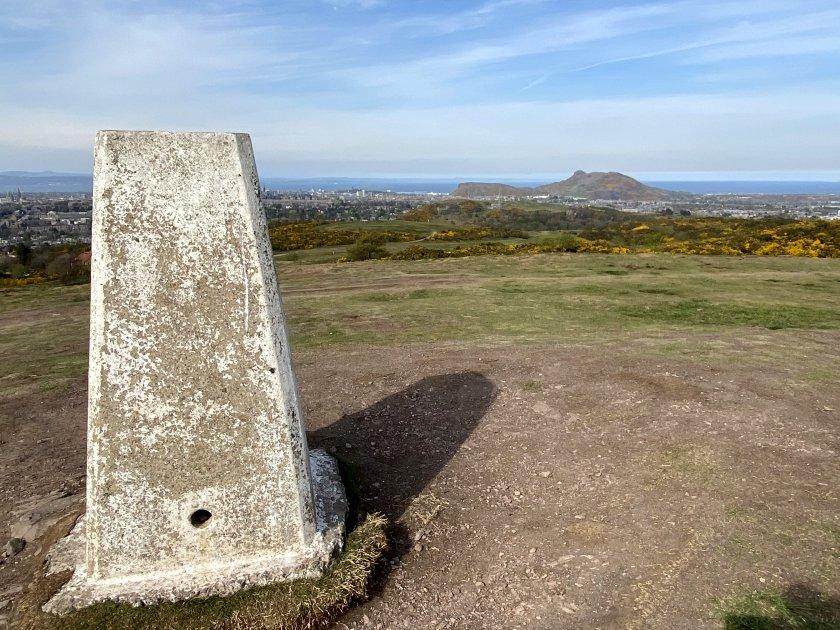 Braid Hills trig point / triangulation station / summit marker, with Arthur's Seat