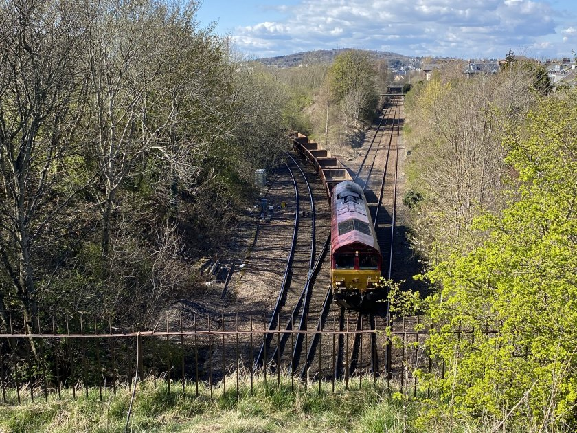 A freight train joins Edinburgh's 'South Suburban' line