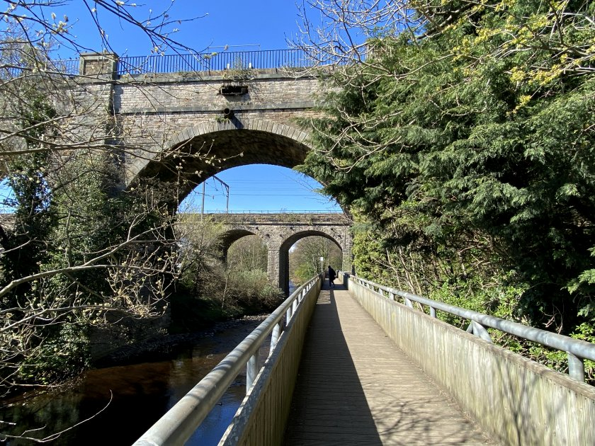 Setting off on the walkway under the Union Canal and the railway to Glasgow Central / Carlisle