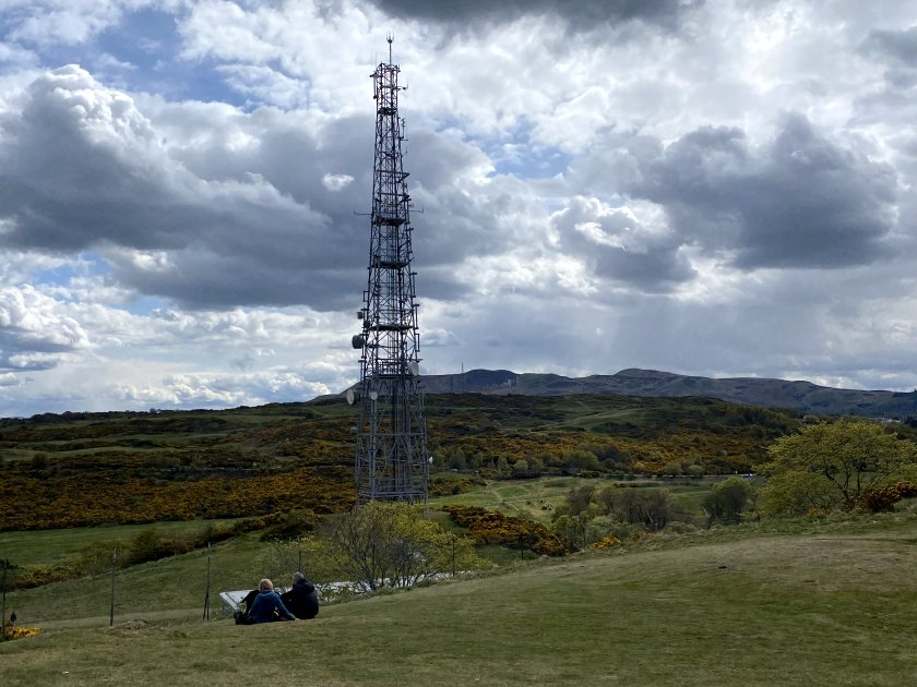 A radio mast is usually a clue that the highest point isn't far away