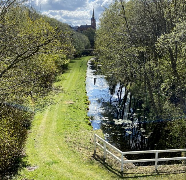 Gartsherrie Cut of the Monkland Canal, with the spire of New St Andrew's Parish Church