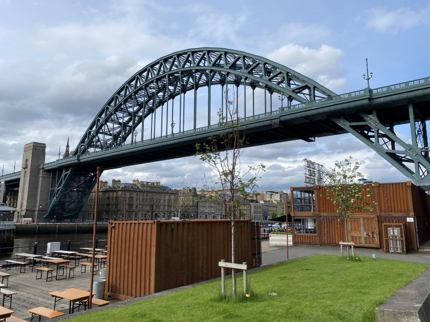 The 'container village' is between the Tyne Bridge and the Swing Bridge, downhill from the Hilton