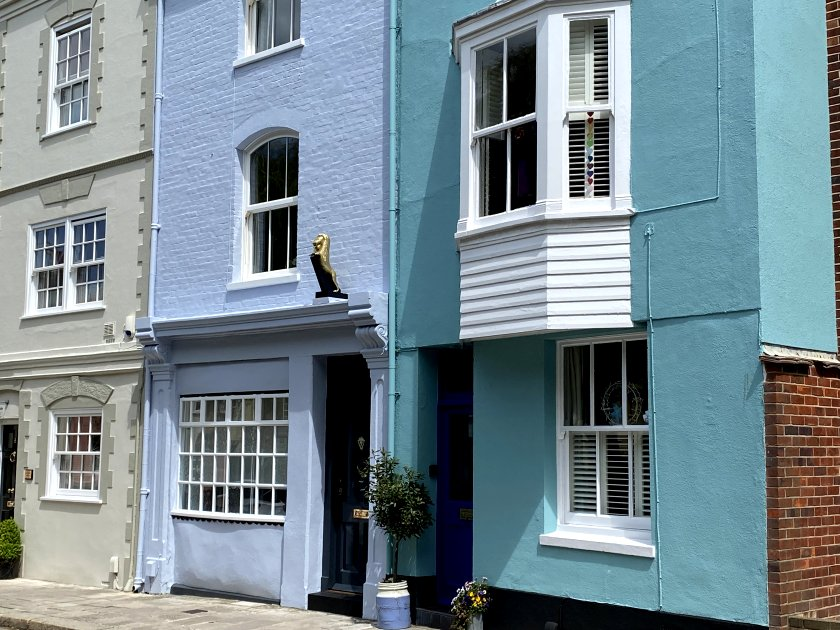 Brightly coloured houses in St Thomas's Street, on the cathedral's north side
