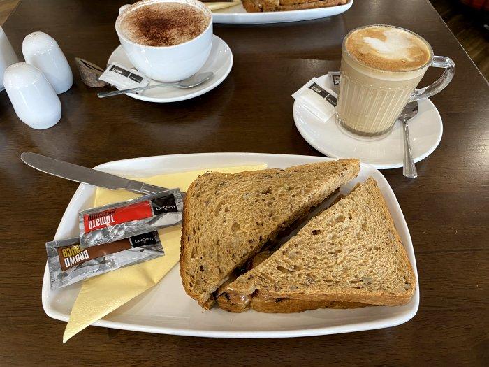 Freshly made breakfast sandwich and tasty coffee