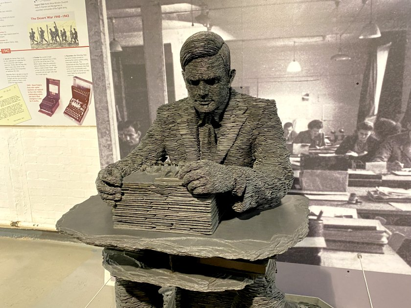 Sculpture of Alan Turing made of Welsh slate